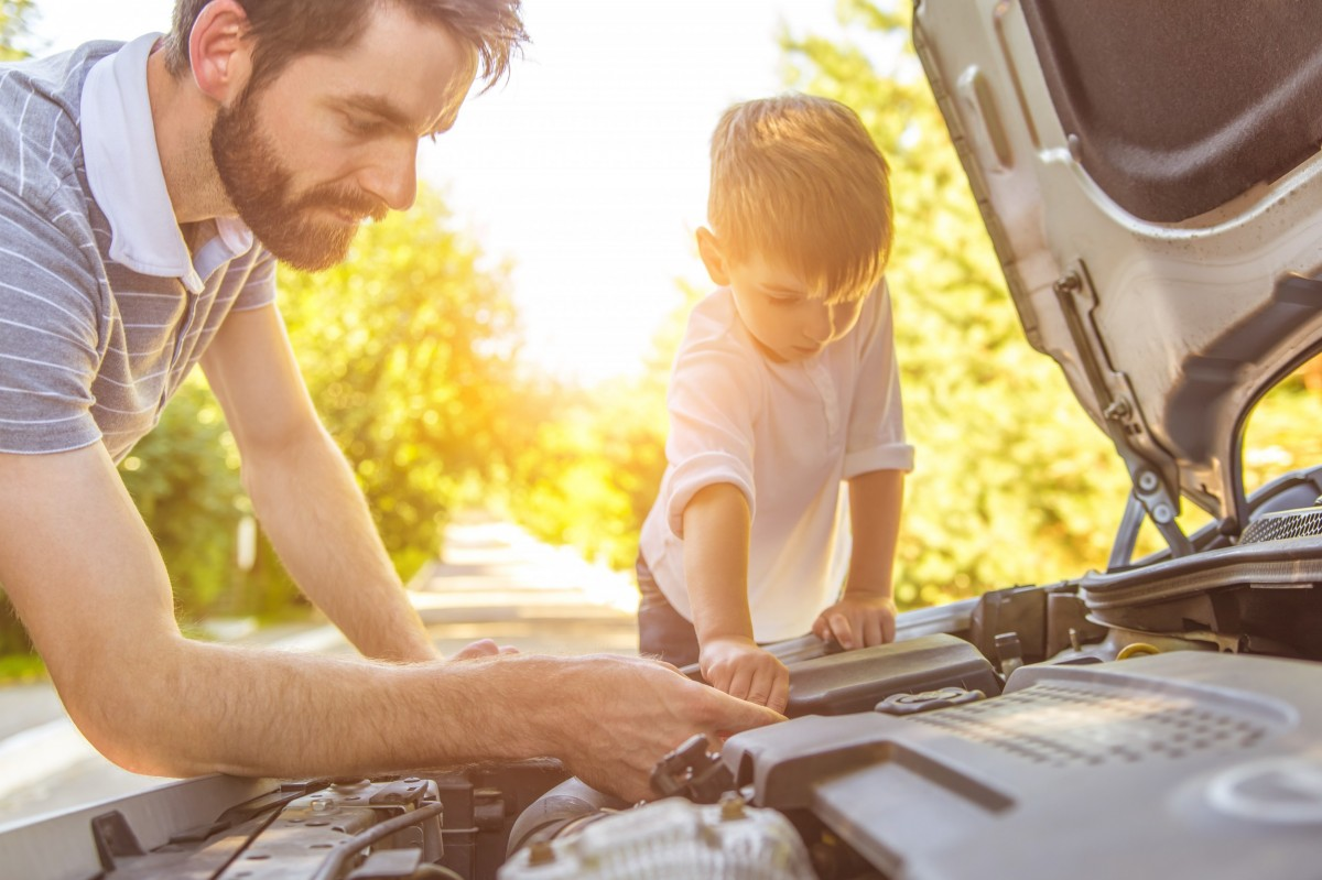 father son working on car
